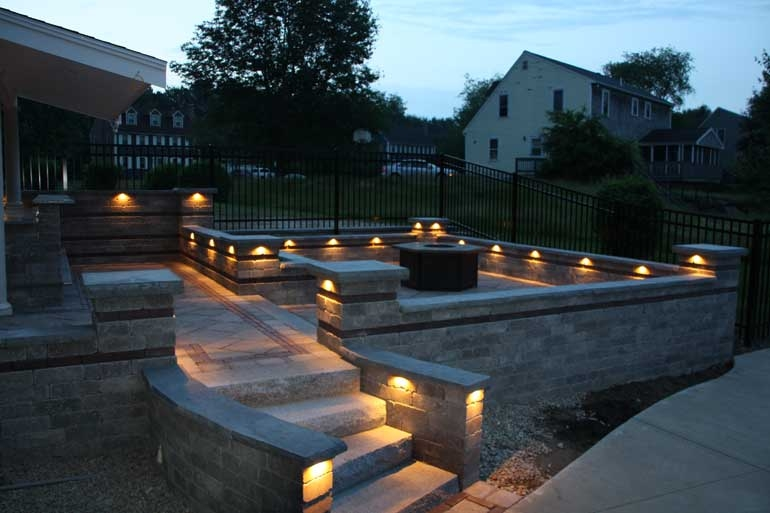 Granite steps and low voltage lighting on retaining walls.
