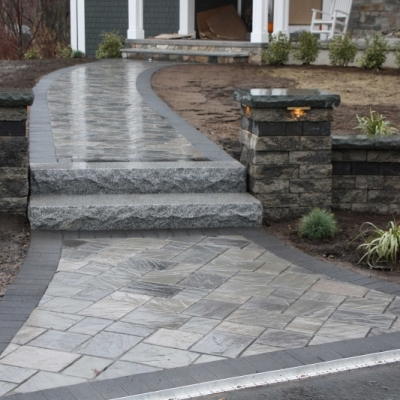 Dawn Mist Richcliff paver field with a border of black granite series 3000 .